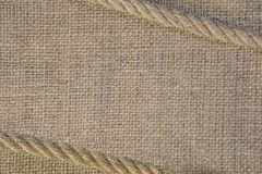 Texture of burlap with cord rope. Template frame of coarse cloth background. Texture of burlap with cord. Template frame of coarse cloth stock image