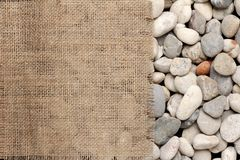 Texture of  Burlap fray on river rock Stock Photography