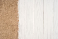 The texture of burlap on white background wooden table. Stock Images