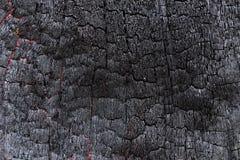 Black Coal Like Burned Wooden Surface Royalty Free Stock Photos