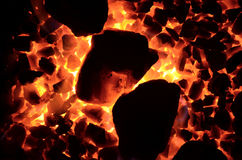 Texture of burning coal. The background of the burning coal is a fine fraction and is stacked diagonally large Royalty Free Stock Photos