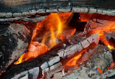 Texture of burning open fireplace. With fire, flame, wood and embers Royalty Free Stock Image
