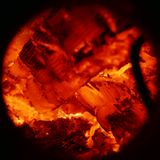 Texture of burning wood charcoal and flames close up Royalty Free Stock Images