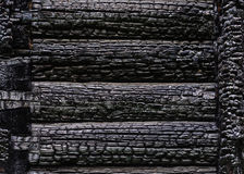Texture of burnt wooden wall background Stock Photos