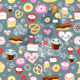 Texture of cakes. Seamless pattern with colorful cakes and hearts on a blue backgroundrnrn stock illustration