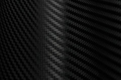 Texture of Carbon Fiber Sticker.Luxury black material Royalty Free Stock Photos