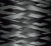 Texture of Carbon Kevlar Fiber material. Dark background Royalty Free Stock Photo