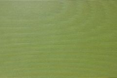 Texture of cardboard green, with stripes embossed grooved. Multilayered, with stripes embossed grooved stock photos