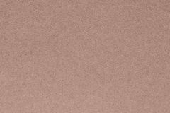 Texture of a cardboard or paper material of pale brown color Stock Photos
