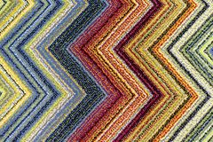 The texture of the carpet with bright multi-colored zigzags royalty free stock images