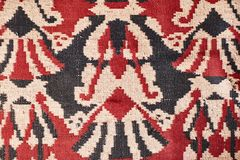 The texture of the carpet. Red old carpet. stock images