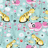 Texture of the cats and fish. Seamless floral pattern of the cats and fish on a light blue background Stock Image