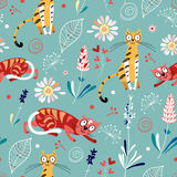 Texture of cats among flowers. Seamless pattern of funny cats among the colorful flowers on a blue background Royalty Free Stock Photos