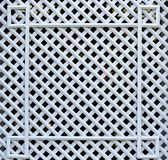 White wooden, square lattice. Texture of cells royalty free stock photography