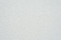 Texture cellulose ceiling.The structure of the false ceiling. Tiles. The rough porous panel to create a ceiling, close-up abstract background royalty free stock photography