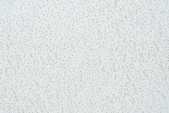 Texture cellulose ceiling.The structure of the false ceiling. Tiles. The rough porous panel to create a ceiling, close-up abstract background stock photos