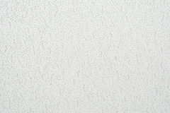 Texture cellulose ceiling.The structure of the false ceiling. Tiles. The rough porous panel to create a ceiling, close-up abstract background stock photo