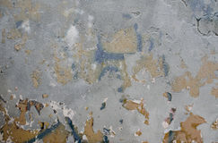 The texture of the cement surface. Is gray with chunks of old paint Stock Photo
