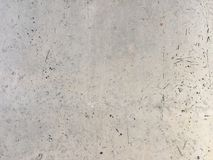 Texture of cement wall. Abstract background texture of close up of marred white cement wall royalty free stock images