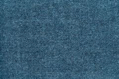 Texture of checkered fabric with blue specks. The textured pure background checkered fabric with specks of blue color Royalty Free Stock Images