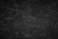 Black chipboard texture. Texture of chipboard in black Stock Photo