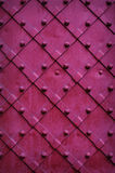 Texture chipped metals doors dark red color Royalty Free Stock Photo