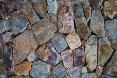 Texture of chipped stone. Texture of fragment of a wall from a chipped stone royalty free stock photography