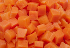 Of texture of chopped carrot in squares. Detail of texture of chopped carrot in squares royalty free stock images
