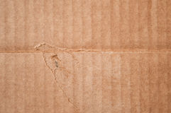Texture of  clean damaged brown cardboard box. Wavy folded paper Royalty Free Stock Photography