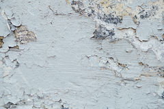 Texture Close Up of Chipped blue peeling paint, covered with cru. Mbling Paint on an Exterior Wall, outdoor Stock Image