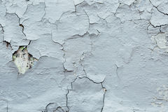 Texture Close Up of Chipped blue peeling paint, covered with cru. Mbling Paint on an Exterior Wall, outdoor Royalty Free Stock Photo