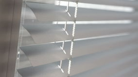 Texture closed aluminum blinds in the office stock footage