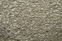 Texture closeup crumpled foil of beige color Stock Photos