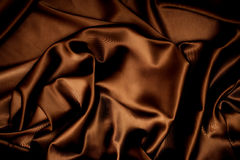 Texture of cloth Chocolate brown satin silk royalty free stock photography