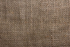 The texture of coarse burlap closeup Stock Images