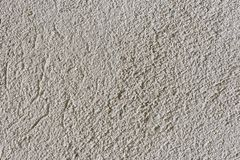 Texture of coarse-grained cement plaster gray. The texture of coarse-grained cement plaster gray royalty free stock images