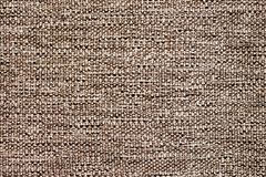 Texture of coarse natural fabric of brown color for design_ Stock Photo