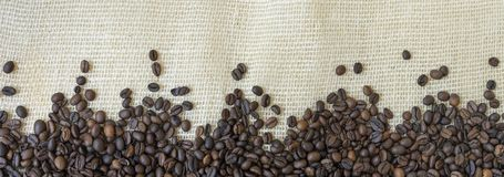 Texture of coffee beans with jute background. Texture of coffee beans with jute bag background royalty free stock photography