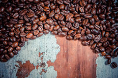 Texture of coffee beans on a wooden background Royalty Free Stock Image