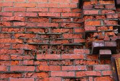 The texture of a collapsing brick wall. Royalty Free Stock Photo