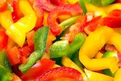 Texture colorée fraîche de paprikas de coupe pour le fond Photographie stock libre de droits