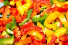 Texture colorée fraîche de paprikas de coupe pour le fond Image libre de droits