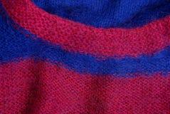 Texture colorée lumineuse de tissu d'un chandail de laine Image stock