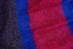 Texture colorée lumineuse de tissu d'un chandail de laine Photo libre de droits