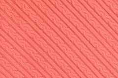 Texture color?e de corail de tissu de tricots photographie stock libre de droits