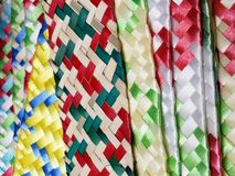 Woven plastic surfaces in various colors, background and texture. Texture and color in mexican craft objects royalty free stock photo