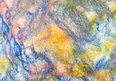 Texture colored felted fabric of dyed sheep's wool and viscose. Royalty Free Stock Photo