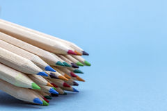 Texture of colored pencils. On blue background royalty free stock photography