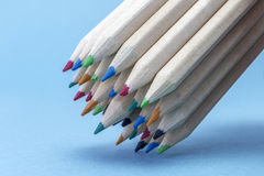 Texture of colored pencils. On blue background royalty free stock image