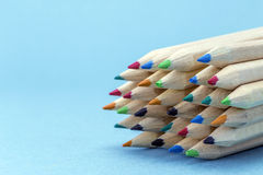 Texture of colored pencils. On blue background stock images
